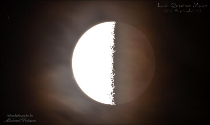 quarter Moon phase through thin clouds